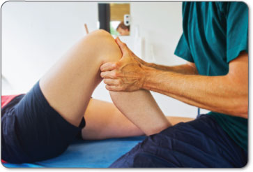 PTs manually manipulate your leg to perform heel slides while massaging different areas of your Achilles tendon and calf muscle